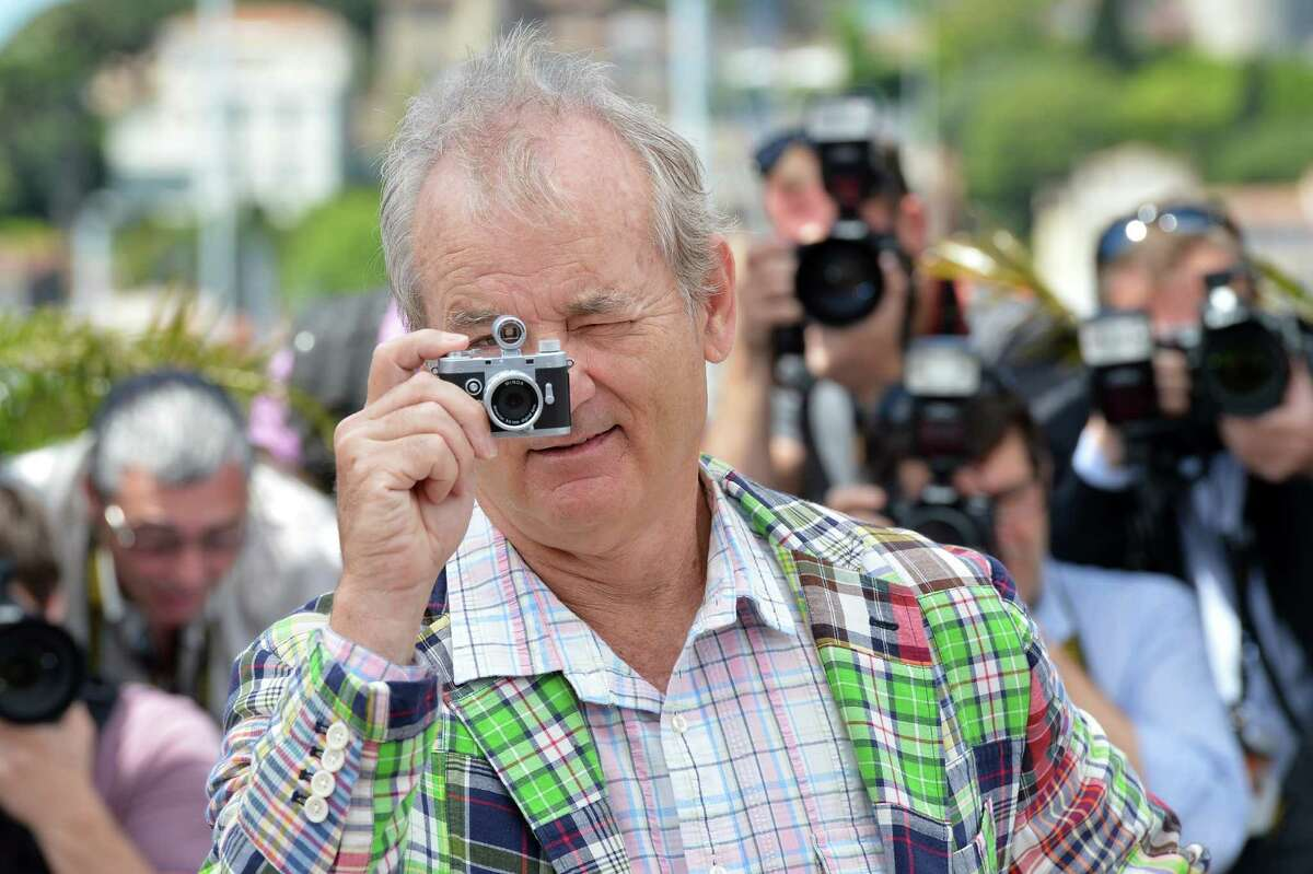 US actor Bill Murray takes a picture with a small camera during the photocall of