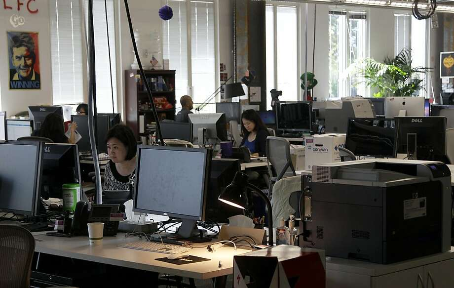 Office workers have better tools, but data show that surfing the Internet eats up time. Photo: Jeff Chiu, Associated Press