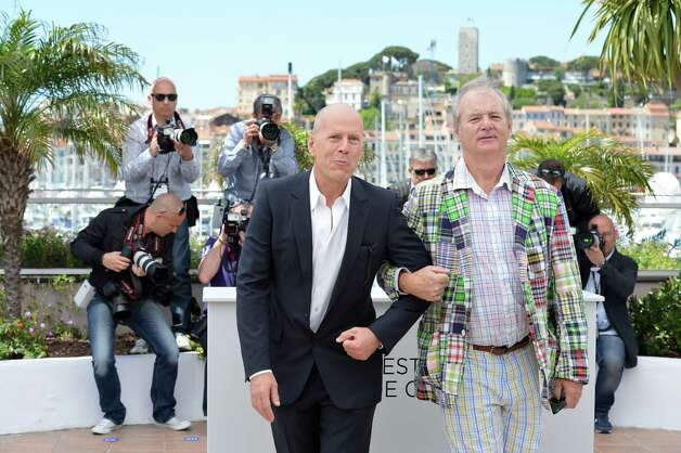 "US actor Bruce Willis (L) and US actor Bill Murray pose during the photocall of ""Moonrise Kingdom"" at the 65th Cannes film festival on May 16, 2012 in Cannes.  AFP PHOTO / ALBERTO PIZZOLI        (Photo credit should read ALBERTO PIZZOLI/AFP/GettyImages) Photo: ALBERTO PIZZOLI, AFP/Getty Images / 2012 AFP"