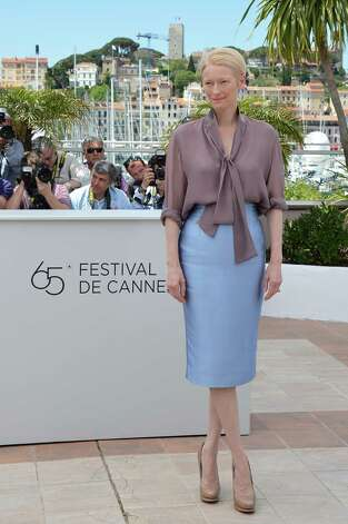"British actress Tilda Swinton poses during the photocall of ""Moonrise Kingdom"" at the 65th Cannes film festival on May 16, 2012 in Cannes.  AFP PHOTO / ALBERTO PIZZOLI        (Photo credit should read ALBERTO PIZZOLI/AFP/GettyImages) Photo: ALBERTO PIZZOLI, AFP/Getty Images / 2012 AFP"
