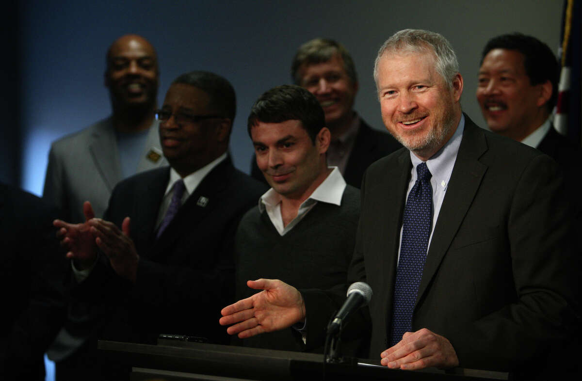 Seattle Mayor Mike McGinn announces a memorandum of understanding on financing of a new NBA and NHL arena in Seattle along with arena investor Chris Hansen, center, during a press conference on Wednesday, May 16, 2012 at King County's Chinook Building.