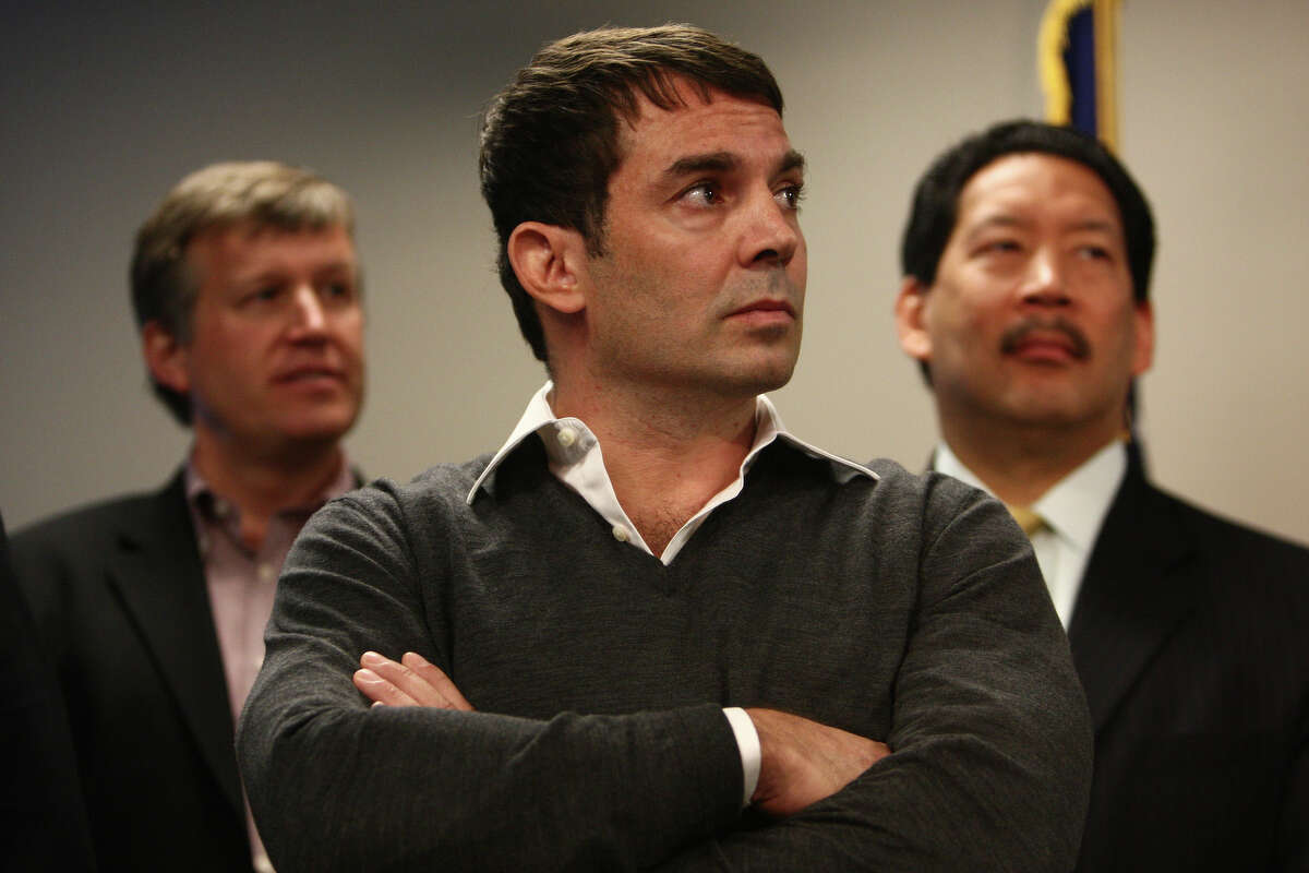 Arena investor Chris Hansen listens during the press conference May 16, 2012, at King County's Chinook Building.