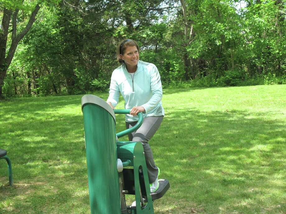 First Selectman Jayme Stevenson shows of the new fitness equipment at Weed Beach. She tries out the cardio stepper here. May 11, 2012. Darien, Conn. Photo: Paresh Jha