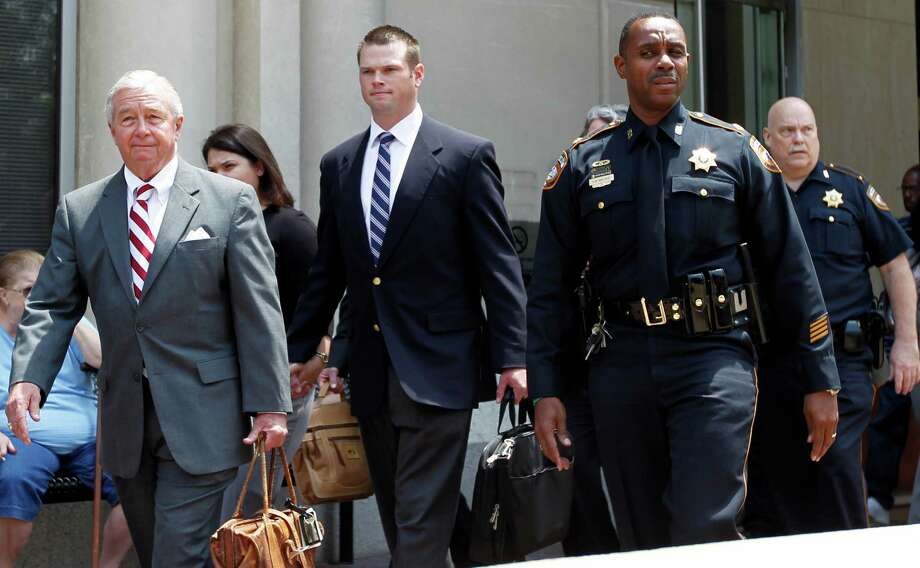 Former HPD officer Andrew Blomberg center, walks out of the Harris County Criminal Justice Center with his attorney Dick DeGuerin left, after being not guilty of official oppression in the videotaped beating of 15-year-old Chad Holley Wednesday, May 16, 2012, in Houston. Photo: James Nielsen, Chronicle / © Houston Chronicle 2012