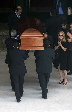 The wife of Mexican writer Carlos Fuentes, Silvia Lemus, receives the coffin with his remains upon arrival at Mexico City's Palacio Nacional de Bellas Artes for a tribute on May 16, 2012. Photo: YURI CORTEZ, AFP/Getty Images / AFP