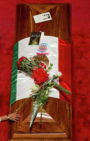 A woman touches the coffin of Mexican writer Carlos Fuentes during his wake at the Fine Art Palace on May 16, 2012 in Mexico City. Photo: ALFREDO ESTRELLA, AFP/Getty Images / AFP