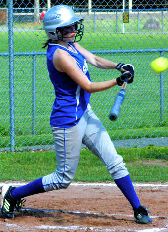 Kelsey Johnson lashes a line drive for Shepaug Valley High School softball, May 11, 2012 at Ayer Field in Washington Depot. Photo: Norm Cummings