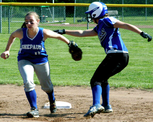 A successful sweep tag by the Spartans' veteran shortstop, Brittany Hartman, makes a Lewis Mills baserunner regret her ill-advised dash for second base during Shepaug Valley High School softball's game, May 11, 2012 at Ayer Field in Washington Depot. Photo: Norm Cummings