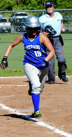 Spartan third baseman Bridget McCarthy beats a path to first base for for Shepaug Valley High School softball as umpire Steve Kolitz looks on, May 11, 2012 at Ayer Field in Washington Depot. Photo: Norm Cummings