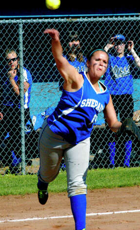 The Spartans' Bridget McCarthy guns a throw across the diamond for Shepaug Valley High School softball as Lewis Mills players check out her technique, May 11, 2012 at Ayer Field in Washington Depot. Photo: Norm Cummings