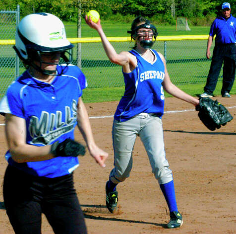 Spartan pitcher Kelsey Johnson demonstrates her fielding skillls for Shepaug Valley High School softball, May 11, 2012 at Ayer Field in Washington Depot. Photo: Norm Cummings