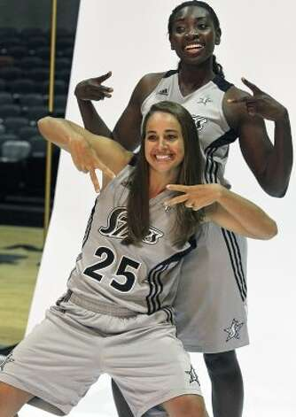 SPORTS  Becky Hammon jumps in to pose with Sophia Young as the Silver Stars participate in media day at the AT&T Center on May 16, 2012.  Tom Reel/ San Antonio Express-News (San Antonio Express-News)
