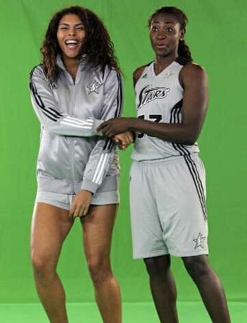 SPORTS   Ziomara Morrison gets spoofed by sophi Young during a video shoot as the Silver Stars participate in media day at the AT&T Center on May 16, 2012.  Tom Reel/ San Antonio Express-News (San Antonio Express-News)