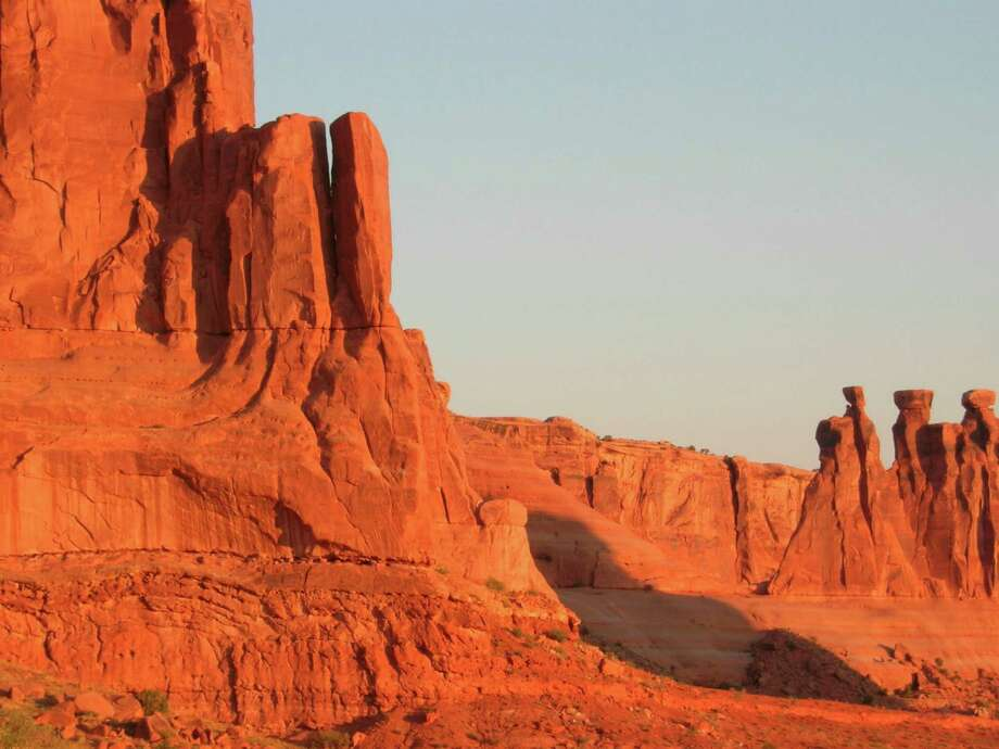 Rock formations in Arches National Park near Moab, Utah, glow in the early-morning sun.  Photo: Kristin Jackson / Seattle Times