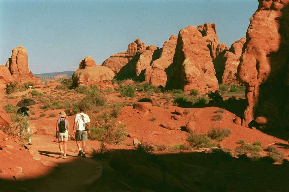 Hikers explore Arches National Park near Moab, Utah.  Photo: Syd Kearney / HOUSTON CHRONICLE