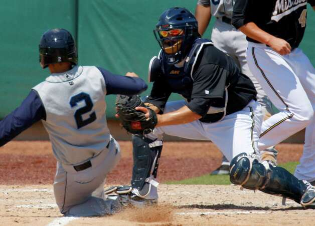 Missions catcher Ali Solis tags out Corpus Christi's Ryan McCurdy in the fourth inning Wednesday, May 16, 2012, at Wolff Stadium. Photo: William Luther, San Antonio Express-News / © 2012 WILLIAM LUTHER