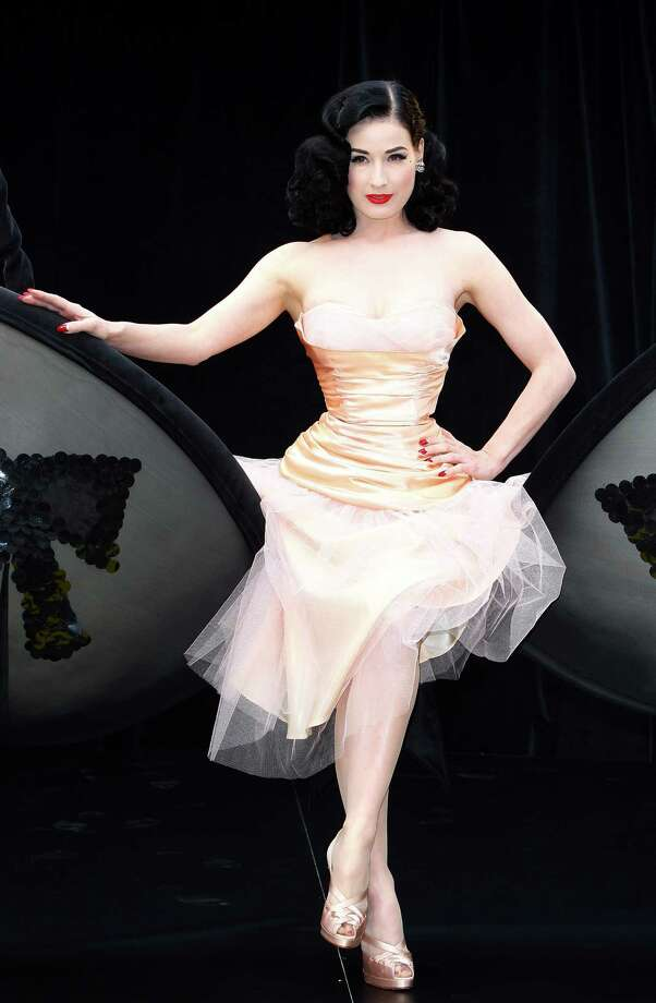 "Often posing as if she's winking to let us know she's in on the joke and understands the lack of gravitas, here Dita poses in a giant bra to launch the new ""Wonderbra by Dita Von Teese"" collection on Sept. 23, 2008 in London. Photo: Gareth Cattermole, Getty Images / 2008 Getty Images"