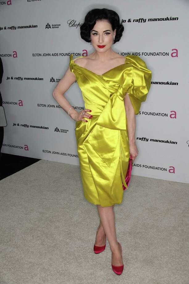 Yellow! A lot of women wouldn't dare wear this color so boldly. Dita arrives in Christian Lacroix at the 17th annual Elton John AIDS Foundation's Academy Award viewing party on Feb. 22, 2009 in Hollywood, Calif. Did she pull it off? Photo: Frederick M. Brown, Getty Images / 2009 Getty Images