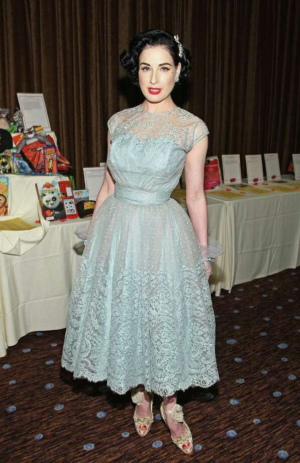 "Dita goes super-girly, in a 1950s way, with a lacy dress, showy barette and bowed sandals at the L.A. Gay and Lesbian Center's ""An Evening with Women: Celebrating Art, Music and Equality"" event on April 24, 2009 in Beverly Hills, Calif. Photo: Alberto E. Rodriguez, Getty Images / 2009 Getty Images"