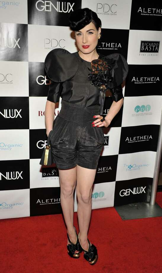 Dita's not afraid to push the boundaries a bit in a shorts Dolce & Gabbana dress with oversized shoulders and brooch and a very '50s-ish hairstyle at the Genlux Magazine's BritWeek Designer Of The Year Fashion Show And Awards on May 2, 2009 in West Hollywood, Calif. Photo: Toby Canham, Getty Images / 2009 Getty Images