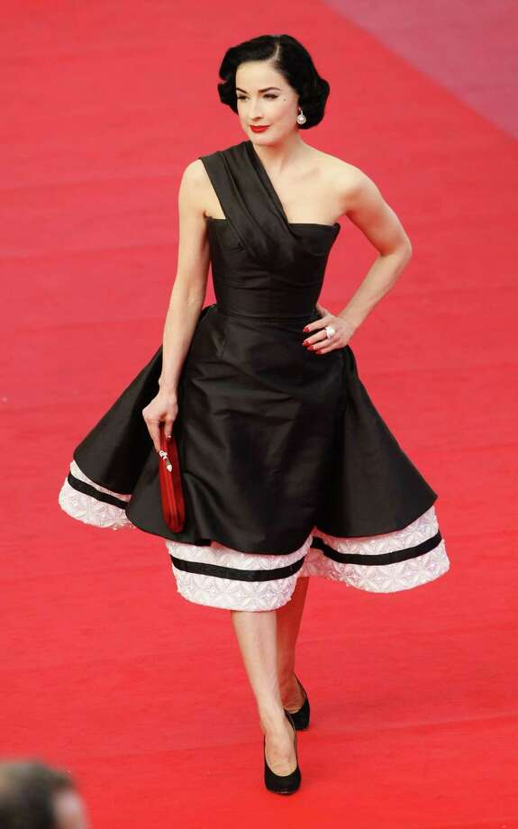Dita turns on a dime to go formal and classy in Christian Dior on the red carpet at Cannes on May 20, 2009. Photo: Kristian Dowling, Getty Images / 2009 Getty Images