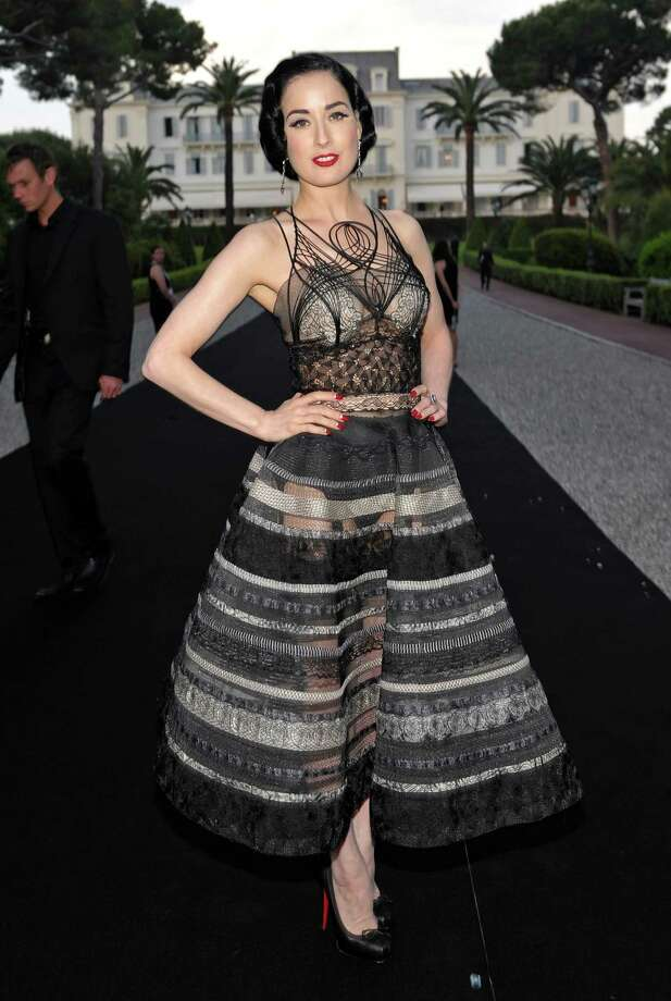 Still at Cannes, Dita lends class to a peek-a-boo Jean Paul Gaultier couture frock on May 21, 2009. Photo: John Shearer, Getty Images For AmfAR / 2009 Getty Images