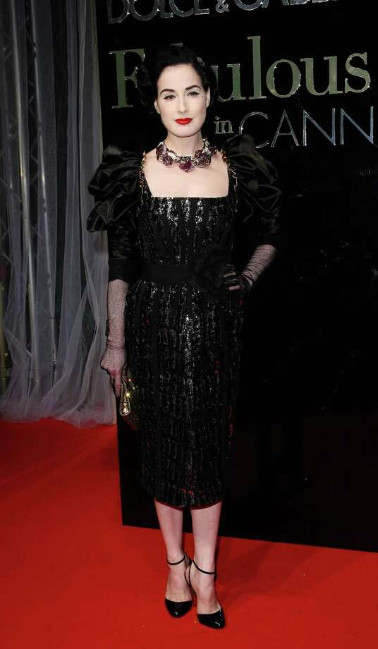 There's a Victiorian flair in this Dolce & Gabbana outfit to go with the lacy sleeves and oversized necklace Dita wore to a party honoring the designers at Cannes on May 22, 2009. Photo: Sean Gallup, Getty Images / 2009 Getty Images