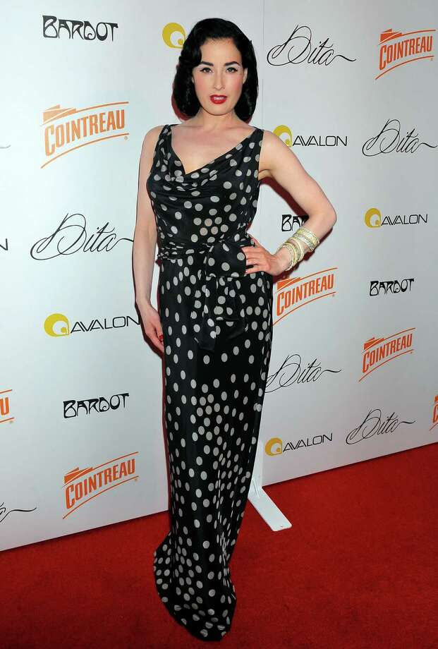 "Dita is a worldwide brand ambassador for Cointreau liqeuer, which simply adds to her voluminous public appearances. Here, she debuts ""Cointreau Teese"" on July 22, 2009 in Hollywood, Calif., in a dress that makes her look much taller than 5-4. Photo: Charley Gallay, Getty Images / 2009 Getty Images"