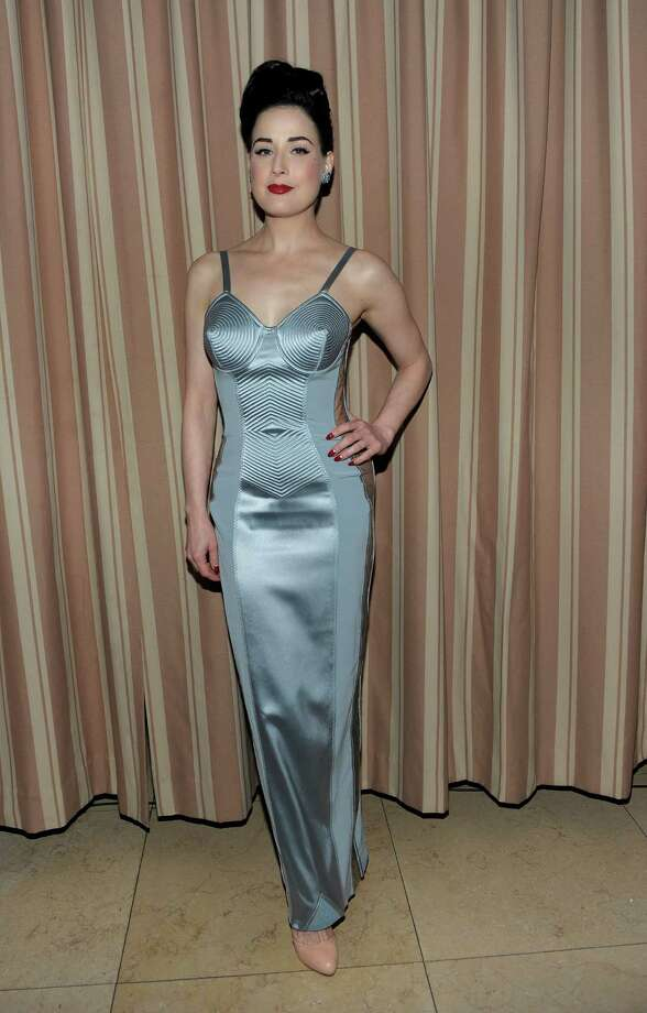 Dita wears a simple, throwback design by Jean Paul Gaultier to the Audi Golden Globes Celebration with nominee Anna Paquin on Jan. 10, 2010 in West Hollywood, Calif. Photo: Michael Buckner, Getty Images / 2010 Getty Images