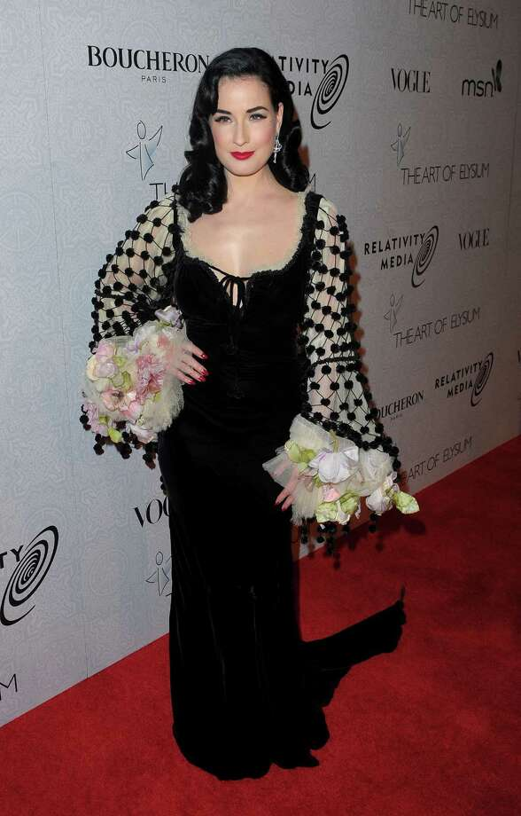Another Jean Paul Gaultier creation, this one evoking the golden age of cinema, as Dita arrives at a charity event on Jan. 16, 2010 in Beverly Hills, Calif. Photo: Jason Merritt, Getty Images / 2010 Getty Images