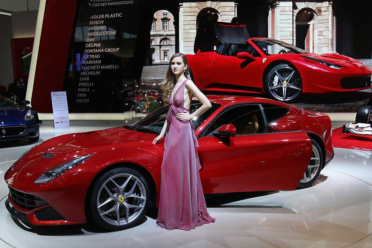 BEIJING, CHINA - APRIL 27: A model stands beside a Ferrari F12 Berlinetta car during the 2012 Beijing International Automotive Exhibition at China International Exhibition Center on April 27, 2012 in Beijing, China. More than 2,000 automotive enterprises from 14 countries and regions participated in the 2012 Beijing International Automotive Exhibition from April 23 to May 2. (Photo by Feng Li/Getty Images)