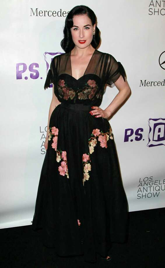 Dita wears a '50s-style dress with floral accents to the 15th Annual Los Angeles Antique Show Opening Night Preview Party on April 21, 2010 in Santa Monica, Calif. Photo: David Livingston, Getty Images / 2010 Getty Images