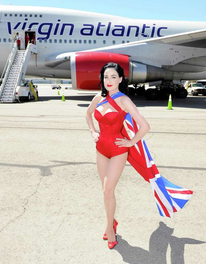 "Dita Von Teese poses on the tarmac in front of ""her"" jet. Photo: Ethan Miller, Getty Images / 2010 Getty Images"