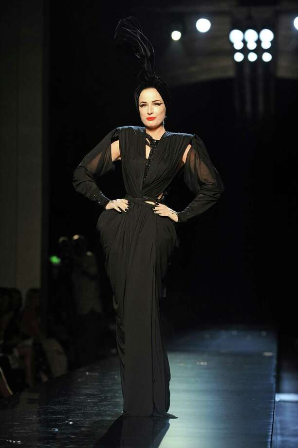 Dita does double duty on the runway during a Jean-Paul Gaultier haute couture show on July 7, 2010 in Paris, first showing a full outfit and an impossibly tiny waist ... Photo: Pascal Le Segretain, Getty Images / 2010 Getty Images