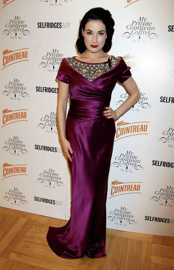 Another new designer for Dita at the same event as she tries on Moschino. Photo: Chris Jackson, Getty Images For Cointreau / 2010 Getty Images