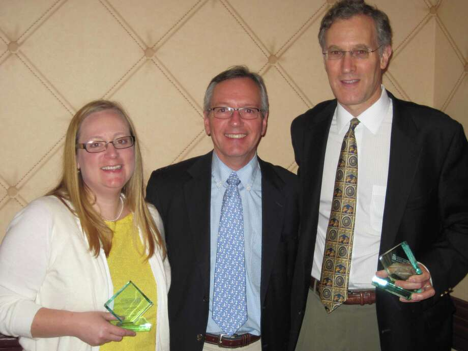 From left, Family Centers staff member Katey Smith, Family Centersí President Bob Arnold and board member Carl Goodnow. Smith and Goodnow were named were named Family Champions by the Connecticut Council of Family Services Agencies on May 9, 2012. Darien, Conn. Photo: Contributed Photo