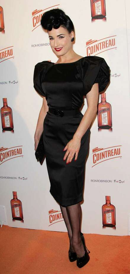 Dita goes back to black and a vintage hairstyle at another Cointreau event on Dec. 9, 2010 in West Hollywood, Calif. Photo: Frederick M. Brown, Getty Images / 2010 Getty Images