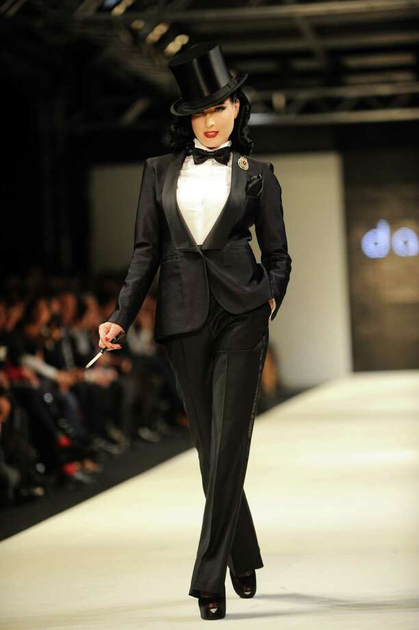 Dita goes all the way to Turkey to model a top hat and tux, a creation by Damat Tween, at Istanbul Fashion Week on Feb. 4, 2011, in Istanbul. Photo: BULENT KILIC, AFP/Getty Images / 2011 AFP