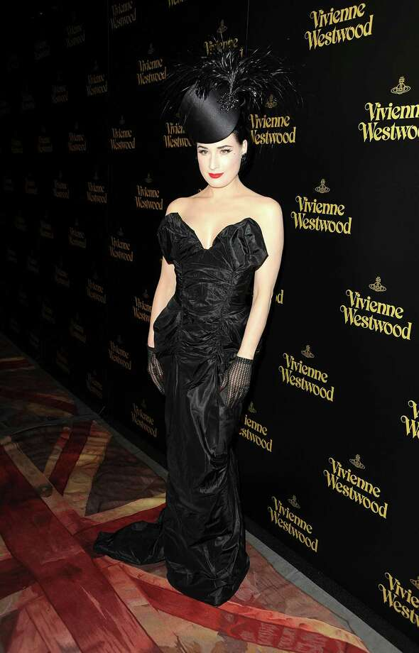 Dita again honors the host by wearing one of her designs -- with vintage chapeau -- as she arrives at the Vivienne Westwood store opening party on March 30, 2011 in Los Angeles. Photo: Frazer Harrison, Getty Images / 2011 Getty Images