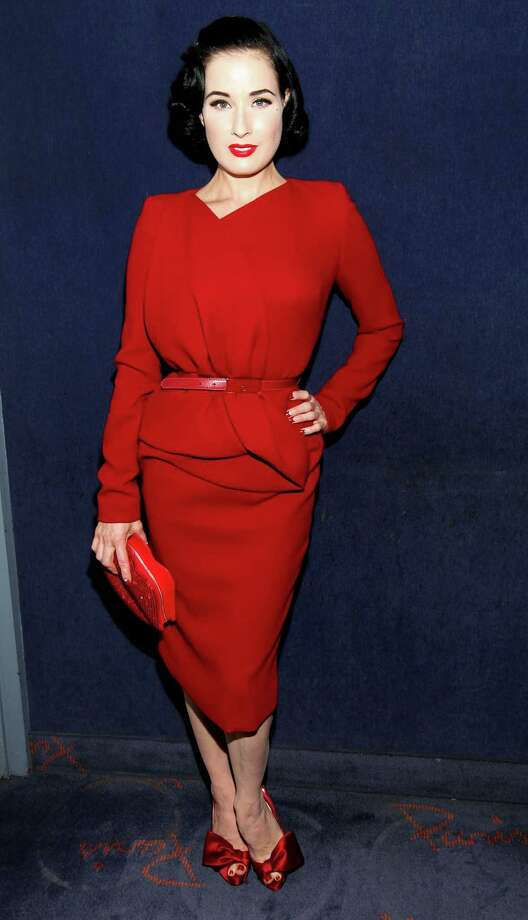 """Dita is on fire in a red Elie Saab outfit with matching handbag, shoes and lipstick at the premiere of """"God Save My Shoes"""" on Sept. 7, 2011 in New York. Photo: Amy Sussman, Getty Images For FIJI Water / 2011 Getty Images"""