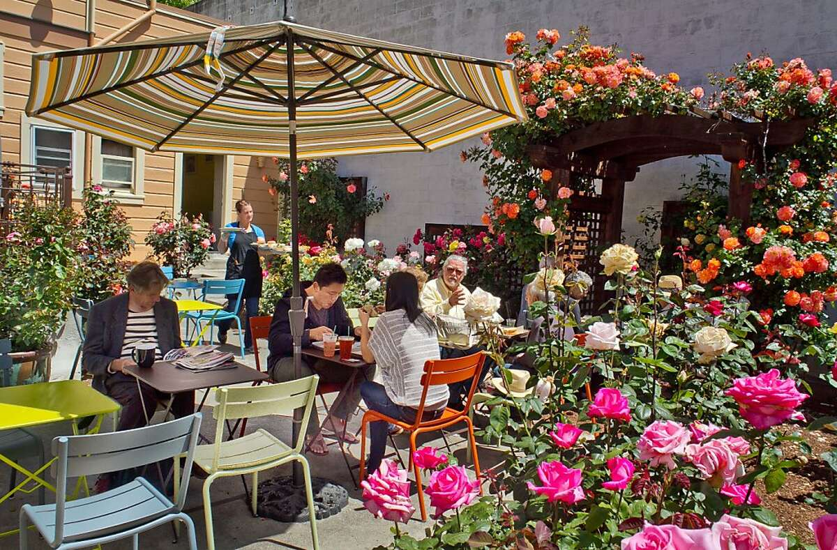 People enjoy lunch in the Rose Garden behind Slow Restaurant in Berkeley, Calif., on Wednesday May 9th, 2012.
