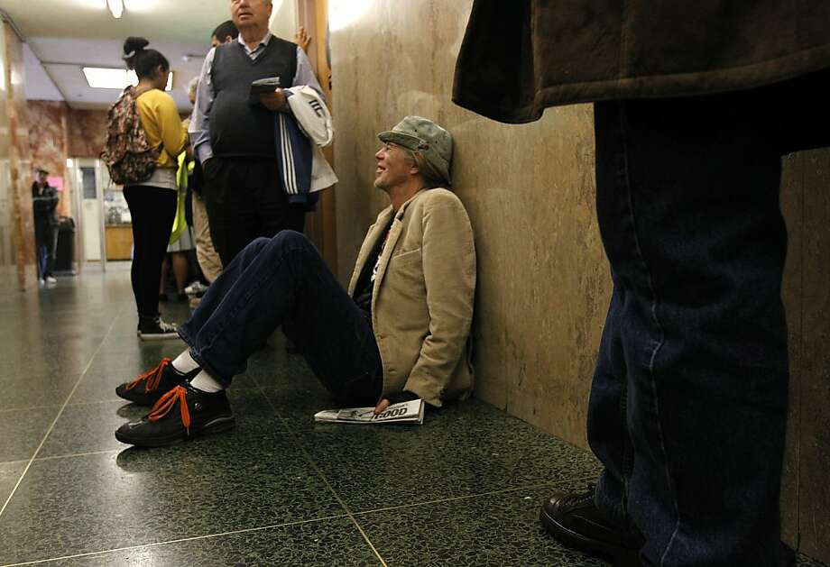 Ken Tillisch takes a seat in the hallway while waiting in line to pay a traffic citation in the Superior Court traffic division at the Hall of Justice in San Francisco, Calif. on Tuesday, May 15, 2012. Photo: Paul Chinn, The Chronicle