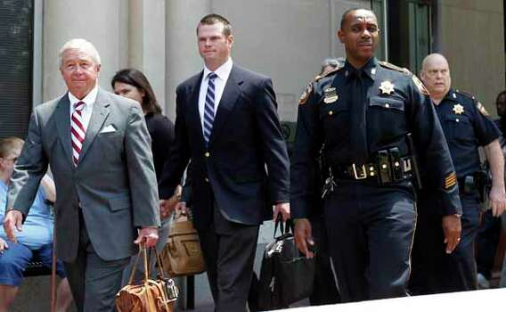 Former HPD officer Andrew Blomberg walks out of the Harris County Criminal Justice Center with his attorney, Dick DeGuerin, left, after being not guilty Wednesday, May 16, 2012. Photo: James Nielsen, Chronicle / © Houston Chronicle 2012
