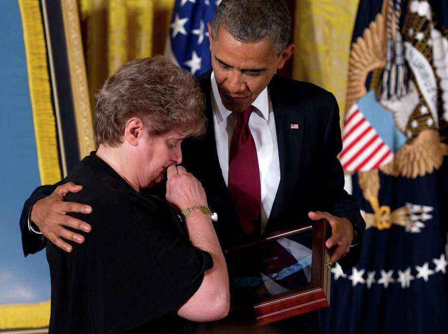President Barack Obama awards posthumously the Medal of Honor to Rose Mary Sabo-Brown, widow of Specialist Leslie H. Sabo, Jr., US Army, during a ceremony in the East Room of the White House in Washington, Wednesday, May 16, 2012. Sabo was killed in 1970 in Cambodia during the Vietnam War. Photo: Carolyn Kaster, Associated Press / AP