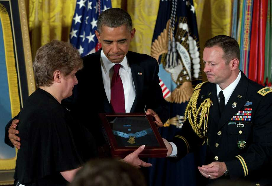 President Barack Obama awards posthumously the Medal of Honor to Rose Mary Sabo-Brown, widow of Specialist Leslie H. Sabo, Jr., US Army, during a ceremony in the East Room of the White House in Washington, Wednesday, May 16, 2012. Photo: Carolyn Kaster, Associated Press / AP