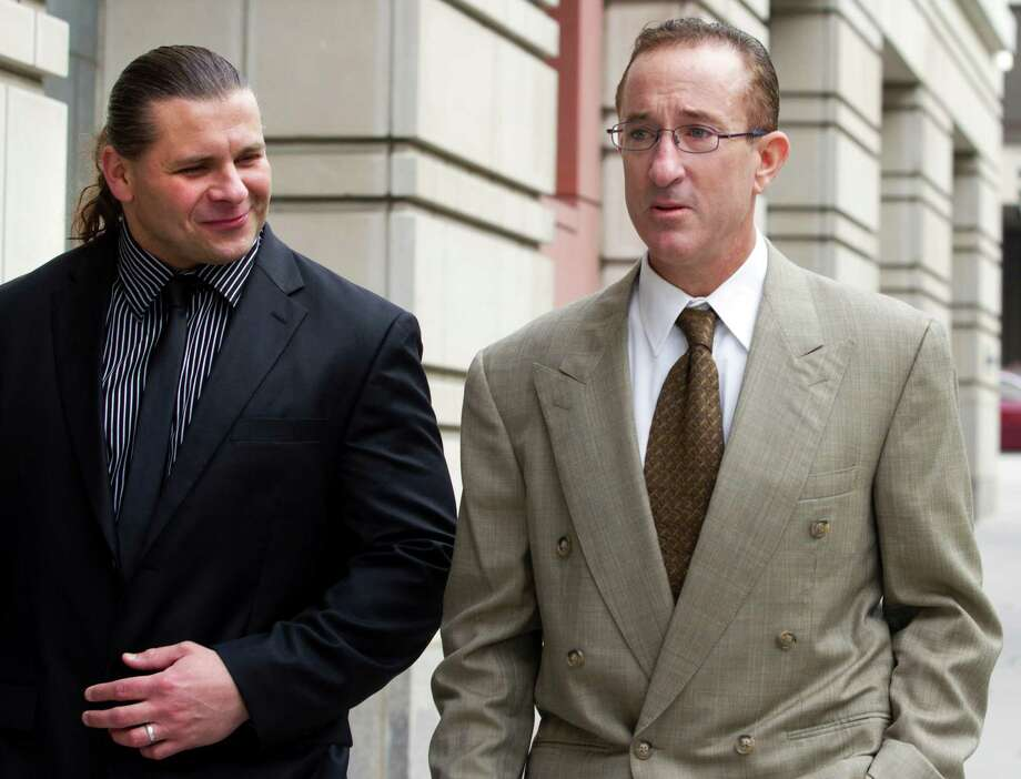 Brian McNamee, right, former trainer of former Major League baseball pitcher Roger Clemens arrives at federal court in Washington, Wednesday, May 16, 2012, for Clemens' perjury trial. (AP Photo/Jacquelyn Martin) Photo: Jacquelyn Martin / AP