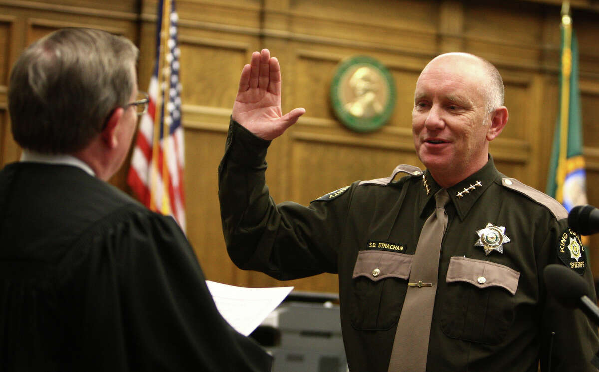 King County Sheriff Steve Strachan is sworn in by King County Superior Court Judge Richard McDermott during a ceremony on Wednesday, May 16, 2012 at the King County Courthouse.