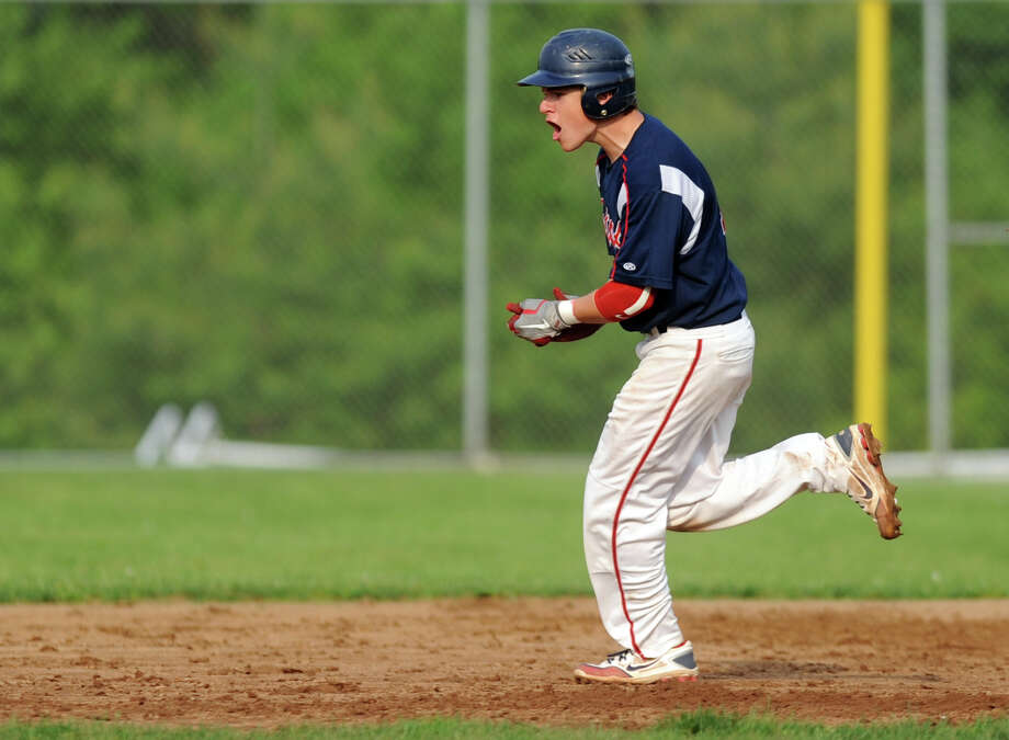 Brien McMahon's Joseph Cox rounds the bases after hitting a home run during Wednesday's baseball game against Staples May 16, 2012 at Brien McMahon High School in Norwalk, Conn. Photo: Autumn Driscoll / Connecticut Post