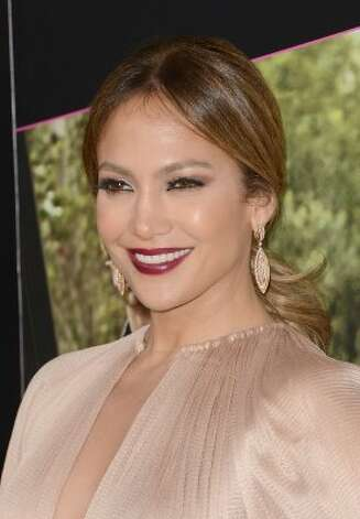 1. Jennifer Lopez  At 42, her gig on American Idol, world tour, clothing line and endorsements brought in $52M in earnings. Her recent divorce has led the singer/actress to revamp herself, and well, it looks like it's working. (Photo by Jason Merritt/Getty Images) (Jason Merritt / Getty Images)