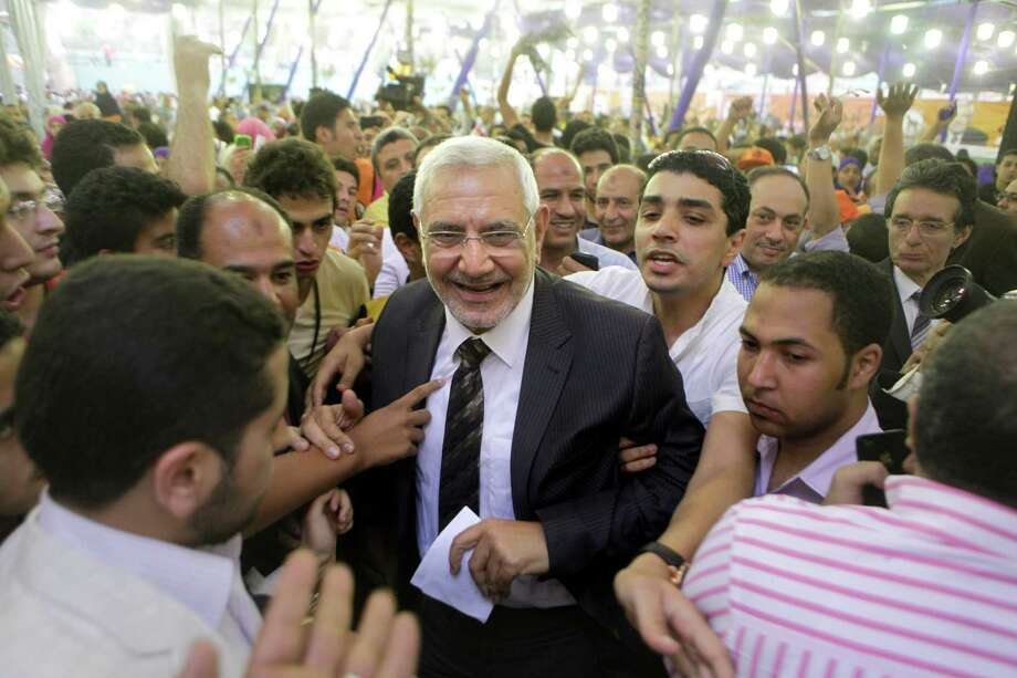 FILE - In this Friday, May 4, 2012 file photo, Egyptian presidential candidate Abdel-Moneim Abolfotoh, center, is surrounded by supporters during a campaign event in El Maadi club in Cairo, Egypt. On the campaign trail for the presidential election, now only nine days away, the Muslim Brotherhood has taken a sharp turn rightward, becoming bolder in saying it wants to bring a state where religiosity and Islamic law play a major role and insisting that it has the right to rule. Photo: Amr Nabil, AP / AP